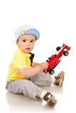 Boy playing with his toy car Royalty Free Stock Images