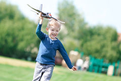 Boy playing his toy plane Royalty Free Stock Photo