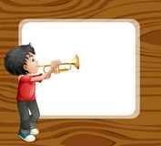 Boy playing with his trombone in front of template Royalty Free Stock Image