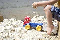 Boy Playing with his Truck Toy at the Beach Sand Stock Photography