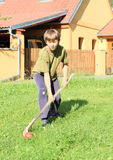 Boy playing hockey Stock Image