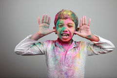 Boy playing Holi Stock Photography
