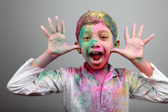 Boy playing Holi Stock Image