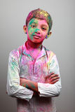 Boy playing Holi Stock Images