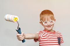 Boy is playing in the house painter. Portrait. Roller for painting.  Stock Image