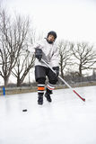 Boy playing ice hockey. Royalty Free Stock Photos