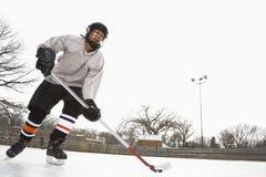 Boy playing ice hockey. Stock Photo