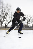 Boy playing ice hockey. Royalty Free Stock Photo