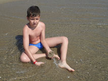 Free Boy Playing In The Sand Royalty Free Stock Image - 56825796