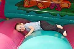 Boy playing on inflatable slide Royalty Free Stock Photo