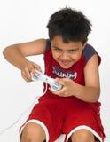 Boy playing with joy stick Stock Photo