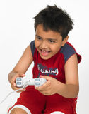 Boy playing with joy stick Stock Images