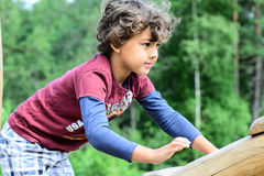 Boy playing. In the jungle gym Royalty Free Stock Photos