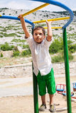 Boy playing on jungle gym Royalty Free Stock Photo
