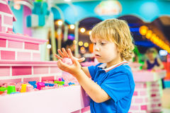 Boy playing with kinetic sand in preschool. The development of fine motor concept. Creativity Game concept Stock Images