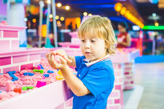 Boy playing with kinetic sand in preschool. The development of fine motor concept. Creativity Game concept Stock Image