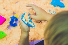 Boy playing with kinetic sand in preschool. The development of fine motor concept. Creativity Game concept Royalty Free Stock Photography