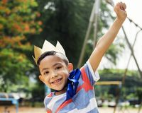 Boy playing king at a playground stock photo