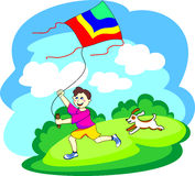 Boy playing with a kite. Smiling little boy playing with a kite outdoors Royalty Free Stock Images