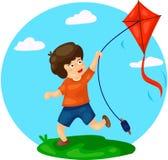 Boy Playing Kite Stock Photo