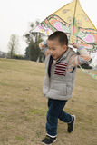 Boy playing kite Royalty Free Stock Photos