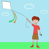 Boy playing with a kite Royalty Free Stock Image