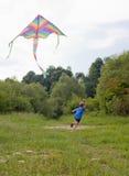 Boy playing with kite Stock Photos