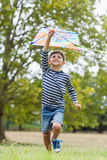Boy playing with kite Royalty Free Stock Photo