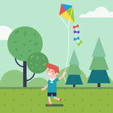 Boy playing with kite in the park Stock Photography