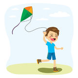 Boy Playing Kite. Young little cheerful boy playing with colorful kite Royalty Free Stock Images
