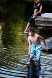 Boy playing in a lake. Young boy playing in a lake in Haliburton County Ontario royalty free stock images