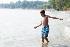 Boy playing in a lake Royalty Free Stock Photos