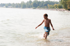 Boy playing in a lake Royalty Free Stock Photo