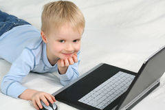 Boy playing on laptop Stock Photography