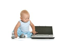 Boy playing with laptop Stock Image