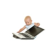 Boy playing with laptop Royalty Free Stock Image