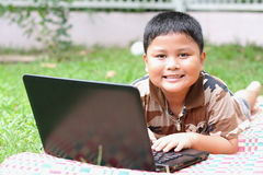 Boy playing laptop. Royalty Free Stock Photos