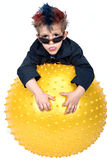 Boy playing with large ball Stock Photos