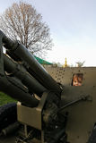 The boy is playing on a large heavy cannon from the times of World War II on the monument to Soviet soldiers Stock Photography