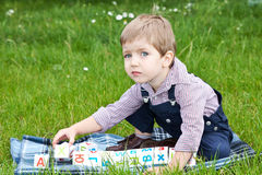 Boy playing on the lawn Royalty Free Stock Photo