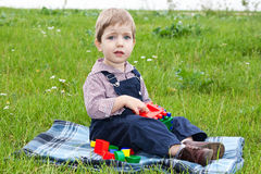 Boy playing on the lawn Stock Images
