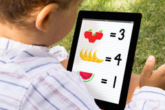 Boy playing and learning with tablet Royalty Free Stock Photography