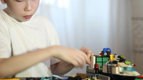 Boy playing with LEGO. stock footage