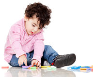 Boy playing with letters Royalty Free Stock Image