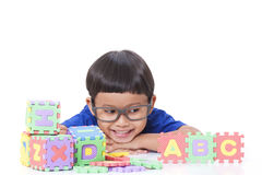 Boy playing with letters Stock Photos