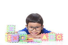 Boy playing with letters Stock Images