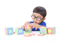 Boy playing with letters Royalty Free Stock Photo