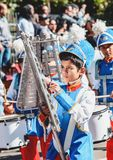 Boy playing Lira instrument at the celebration of the 119 years. Campo Grande, Brazil - August 26, 2018: Civic Parade desfile civico at 13 de Maio street. Boy royalty free stock photography