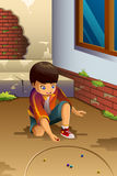 Boy Playing Marbles Stock Images