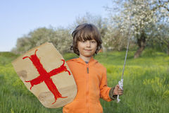Boy playing in medieval knight stock image